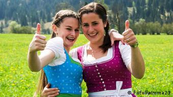 Two young women wearing dirndl dresses © mma23 - Fotolia.com