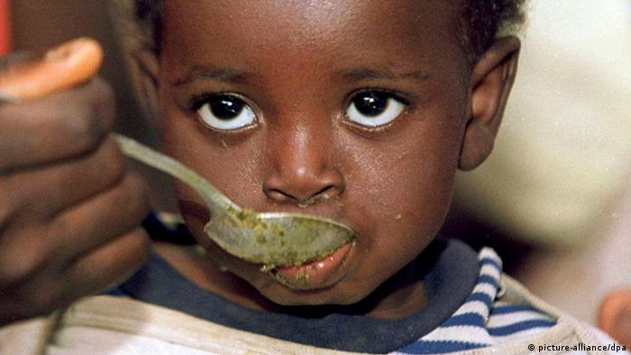 A child eating from a spoon in Sierra Leone