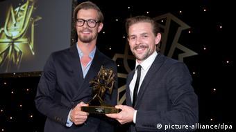 Joko Winterscheidt and Klaas Heufer-Umlauf receiving a Rose d'Or award (picture-alliance/dpa)