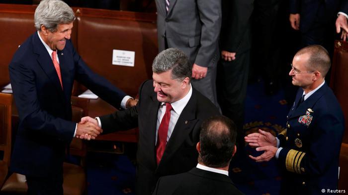US Secretary of State John Kerry shakes Ukrainian President Petro Poroshenko's hand as the Poroshenko enters US Congress&lt;br /&gt;&lt;br /&gt;&lt;br /&gt;&lt;br /&gt;&lt;br /&gt;&lt;br /&gt;&lt;br /&gt;&lt;br /&gt;&lt;br /&gt;&lt;br /&gt;&lt;br /&gt;&lt;br /&gt;&lt;br /&gt;&lt;br /&gt;&lt;br /&gt;<br /> Photo: REUTERS/Kevin Lamarque