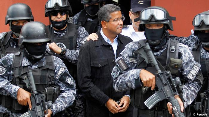 Late president Francisco Flores is guarded by an elite police, armed with assault rifles, unit when leaving his house in 2014