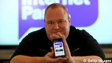 AUCKLAND, NEW ZEALAND - MARCH 27: Kim Dotcom poses for a portrait with his smartphone app after the Internet Party was launched at the Dotcom Mansion on March 27, 2014 in Auckland, New Zealand. The Internet Party today launched its membership drive with members paying $1.29 to join up. (Photo by Phil Walter/Getty Images)