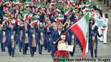 Iran's Behdad Salimi carries his national flag as he leads their delegation parade during the opening ceremony of the 2014 Asian Games at the Incheon Asiad Main Stadium in Incheon on September 19, 2014. AFP PHOTO / JUNG YEON-JE (Photo credit should read JUNG YEON-JE/AFP/Getty Images)