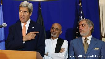 US Secretary of State John Kerry, from left, speaks as Afghan presidential candidates Ashraf Ghani Ahmadzai and Abdullah Abdullah listen during a joint press conference in Kabul. Afghanistan's two presidential candidates were set to a sign a power-sharing deal on national TV on Sunday, three months after a disputed runoff that threatened to plunge the country into turmoil and complicate the withdrawal of US and foreign troops (AP Photo/Rahmat Gul, File)