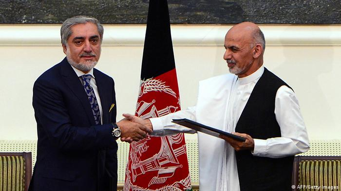 Afghan presidential candidates Abdullah Abdullah (L) and Ashraf Ghani Ahmadzai shake hands after signing a power-sharing agreement at the Presidential Palace in Kabul on September 21, 2014 (Photo: WAKIL KOHSAR/AFP/Getty Images)