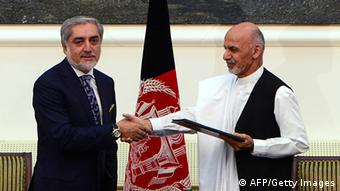 Abdullah Abdullah (L) and Ashraf Ghani shake hands after signing a power-sharing agreement at the Presidential Palace in Kabul on September 21, 2014 (Photo: WAKIL KOHSAR/AFP/Getty Images)