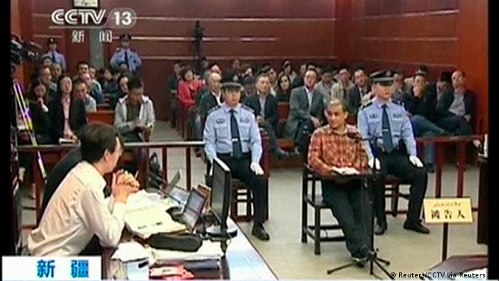 Ilham Tohti facing a trial (Reuters/CCTV via Reuters TV)