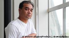 Files - University professor, blogger, and member of the Muslim Uighur minority, Ilham Tohti pauses before a classroom lecture in Beijing on June 12, 2010. Photo: Frederic J. BROWN/afp/dpa (zu dpa Uigurischer Regimekritiker in China zu lebenslanger Haft verurteilt vom 23.09.2014) +++(c) dpa - Bildfunk+++