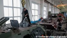 Employees work on armoured personnel carriers at the 141th Zhytomyr Armor Mechanical Repair Plant in Zhytomyr September 23, 2014. REUTERS/Valentyn Ogirenko (UKRAINE - Tags: MILITARY)