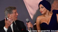 Bildunterschrift:US singers Lady Gaga (R) and Tony Bennett give a press conference to launch their album 'Cheek to Cheek', in Brussels, on September 22, 2014. Lady Gaga and Tony Bennett are in Brussels to perform a mini-concert on the city's 'Grande Place', to film a video clip and officially launch their duo album. AFP PHOTO / EMMANUEL DUNAND (Photo credit should read EMMANUEL DUNAND/AFP/Getty Images)