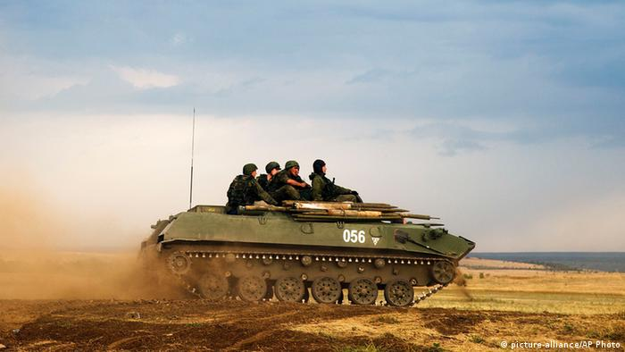 An armored vehicle carrying troops in Ukraine Photo: AP Photo/Pavel Golovkin