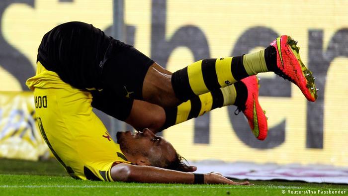 A Dortmund player rests on his back after missing a shot on goal