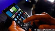 A BlackBerry Passport smartphone is shown at its official launching event in Toronto, September 24, 2014. BlackBerry launched an unconventional new smartphone dubbed the Passport on Wednesday, as it embarked on potentially the most critical phase of its long turnaround push. REUTERS/Aaron Harris (CANADA - Tags: BUSINESS SCIENCE TECHNOLOGY TELECOMS)