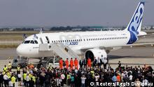 Flight test engineers and heads of Airbus stand in front of the Airbus A320neo (New Engine Option) after its first flight in Colomiers near Toulouse, southwestern France, September 25, 2014. Airbus began the maiden test flight on Thursday of an upgraded passenger jet on which it expects to generate hundreds of billions of dollars of revenue in the coming two decades.The A320neo took off in hazy sunshine in Toulouse, 27 years after the original A320 first took to the skies and opened up fierce competition with Boeing's medium-haul 737. REUTERS/ (FRANCE - Tags: BUSINESS TRANSPORT)
