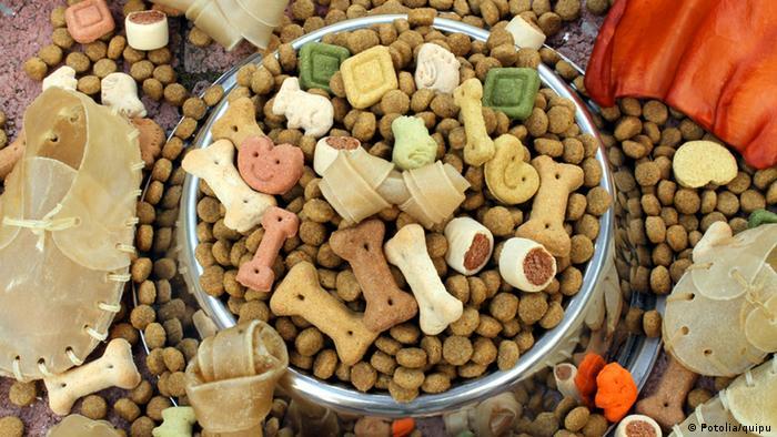 A bowl of dog food and dog treats
