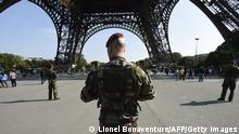 Paratroopers patrols under the Eiffel Tower on September 23, 2014 in Paris, a day after the radical Islamic State group, which controls large areas of Iraq and Syria, called on Muslims to kill citizens of countries taking part in the US-led coalition against the jihadists, which includes France. AFP PHOTO LIONEL BONAVENTURE (Photo credit should read LIONEL BONAVENTURE/AFP/Getty Images)