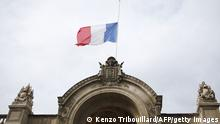 A picture taken on July 28, 2014, shows a French flag flying half-mast at the Elysee Palace in Paris. France on July 26 said flags on every public building would fly at half-mast for three days from July 28 to mourn an Air Algerie crash that killed 118 people on board including 54 French nationals. The presidency said it was not an official national mourning period, which needs to be decided at cabinet meetings, but just a sign of mourning. AFP PHOTO / KENZO TRIBOUILLARD (Photo credit should read KENZO TRIBOUILLARD/AFP/Getty Images)