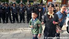 epa04418422 Security guards stand outside the Mingtong Elementary School after a stampede killed six students and injured 22 in Kunming in Yunnan province, China, 26 September 2014. The stampede took place in the staircase of a dorm building during the noon break. EPA/STR CHINA OUT