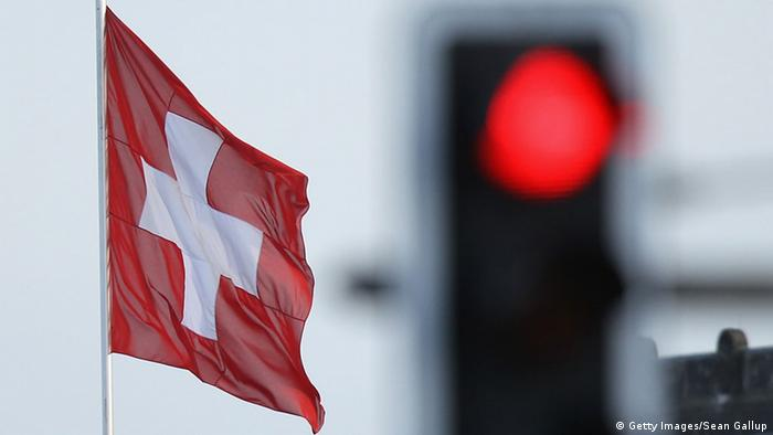 Swiss flag and red traffic light