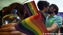 A gay couple kiss during the Pride Parade in Belgrade on September 28, 2014. Serbian gays and lesbians staged their first Belgrade Pride Parade in four years on Sunday, in what is seen as a test of the EU hopeful's commitment to protecting minority rights. With tight security, the march went off without incident, led off from the main government building, with hundreds of participants carrying rainbow-colored balloons and flags, and banners proclaiming Pride, Peace and Love. AFP PHOTO / ANDREJ ISAKOVIC (Photo credit should read ANDREJ ISAKOVIC/AFP/Getty Images)