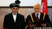 Afghanistan's new President Ashraf Ghani Ahmadzai (L) stands next to Afghanistan's Chief Justice Abdul Salam Azimi as he takes the oath during his inauguration as president in Kabul September 29, 2014. Afghanistan inaugurated its first new president in a decade on Monday, swearing in technocrat Ashraf Ghani to head a power-sharing government just as the withdrawal of most foreign troops presents a crucial test. REUTERS/Omar Sobhani (AFGHANISTAN - Tags: POLITICS TPX IMAGES OF THE DAY)