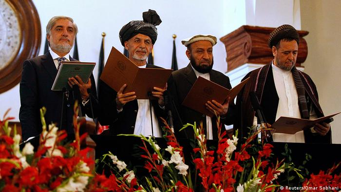 Afghanistan's new President Ashraf Ghani Ahmadzai (2nd L) stands next to Afghanistan's Chief Executive Abdullah Abdullah (L) and his deputies as he takes the oath during his inauguration as president in Kabul September 29, 2014 (Photo: REUTERS/Omar Sobhani)