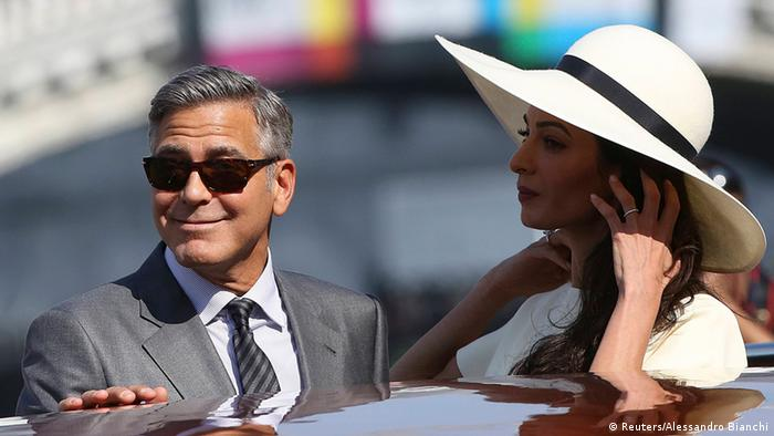 George Clooney and Amal Alamuddin in boat (Reuters/Alessandro Bianchi)