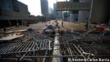 A barricade of metal fences is seen as protesters block a street, near the government headquarters in Hong Kong September 30, 2014. Tens of thousands of pro-democracy protesters extended a blockade of Hong Kong streets on Tuesday, stockpiling supplies and erecting makeshift barricades ahead of what some fear may be a push by police to clear the roads before Chinese National Day. REUTERS/Carlos Barria (CHINA - Tags: POLITICS CIVIL UNREST)