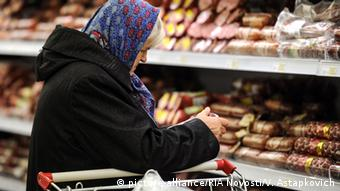 A Russian woman shops for food