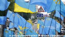 ITAR-TASS: KIEV, UKRAINE. MAY 18, 2014. People wave Ukrainian and Crimean Tatar flags at a United country: Crimea - Ukraine rally to mark the 70th anniversary of the Crimean Tatar deportation, in Kyiv's Shevchenko Park. (Photo ITAR-TASS/ Zurab Dzhavakhadze)