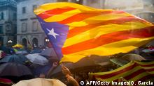 A protester waves a Catalan independentist flag during a demonstration at Placa Sant Jaume in Barcelona on September 30, 2014, a day after Spain's Constitutional Court ordered the suspension of a planned referendum on independence. Catalan leaders launched a legal battle today to get their drive for a referendum on independence from Spain back on track after a court suspended it. Angry separatists in the region planned protests after Spain's Constitutional Court halted the plan to hold the vote on November 9. AFP PHOTO / QUIQUE GARCIA (Photo credit should read QUIQUE GARCIA/AFP/Getty Images)