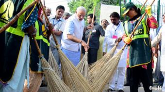 Prime Minister Narendra Modi launching cleanliness drive as part of the Swachh Bharat Abhiyan at Valmiki Basti where Mahatma Gandhi stayed in New Delhi on Thursday