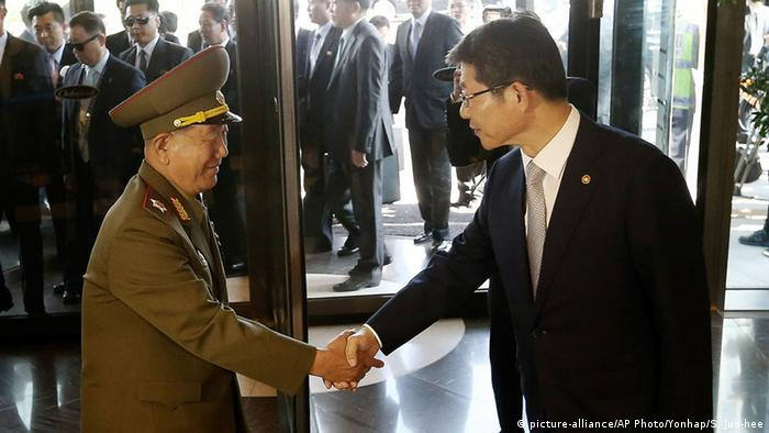 Hwang Pyong So, left, vice chairman of North Korea's National Defense Commission, shakes hands with South Korean Unification Minister Ryoo Kihl-jae upon his arrival at a hotel in Incheon, South Korea, Saturday, Oct. 4, 2014. AP Photo/Yonhap, Shin Jun-hee) KOREA OUT