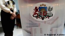 Ballots are seen in a ballot box during Latvia's parliamentary elections in Riga October 4, 2014. REUTERS/Ints Kalnins (LATVIA - Tags: POLITICS ELECTIONS)