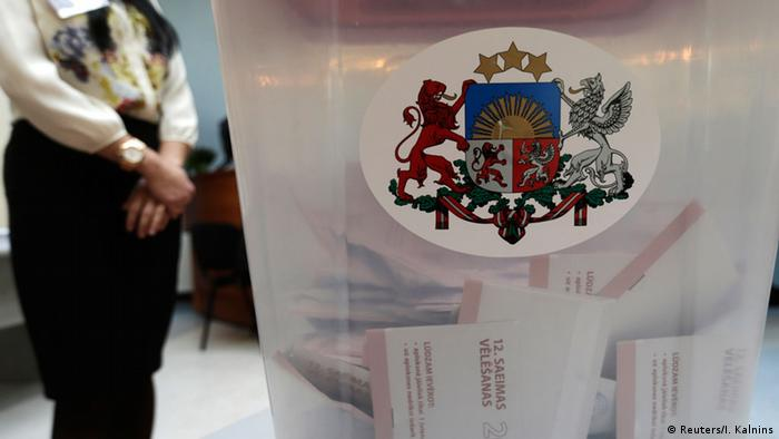 Ballots are seen in a ballot box during Latvia's parliamentary elections in Riga October 4, 2014. REUTERS/Ints Kalnins