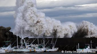 High waves batter a breakwater at a port at Kihou town in Mie prefecture, central Japan on October 6, 2014. Strong typhoon Phanfone slammed into Japan, packing gusts and huge waves that have already swept three US military officials out to sea, as it made a beeline for Tokyo.
