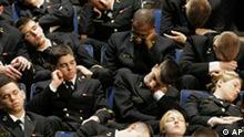 Naval Academy midshipmen sleep in their seats as they wait for President George Bush to arrive at the Academy in Annapolis, Md., Wednesday, Nov. 30, 2005. Bush is scheduled to give a speech later in the morning. (AP Photo/Chris Gardner)