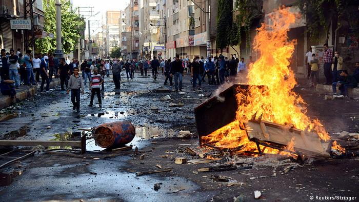 Kurdish protesters set fire to a barricade