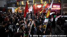 HAMBURG, GERMANY - OCTOBER 08: Kurdish protesters shout slogans and walk by 'Eros Corner', a brothel on the Hamburg-Reeperbahn, during a rally against IS terror on October 8, 2014 in Hamburg, Germany. Hamburg was shaken by violence during the last two nights, members of the Kurdish community and Salafists were using machetes and knifes to threaten each other. (Photo by Alexander Koerner/Getty Images)