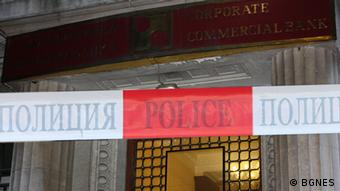 Red and white tape blocks the entrance to the bank.