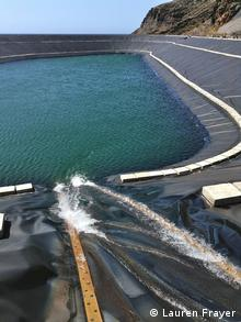 Water flows into a sea-level artificial lake, after passing through turbines to generate electricity (Photo: Lauren Frayer/DW)