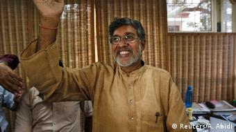 Indian children's right activist Kailash Satyarthi waves to the media at his office in New Delhi October 10, 2014. Pakistani teenager Malala Yousafzai, who was shot in the head by the Taliban in 2012 for advocating girls' right to education, and Satyarthi won the 2014 Nobel Peace Prize on Friday. Satyarthi, 60, and Yousafzai were picked for their struggle against the oppression of children and young people, and for the right of all children to education, the Norwegian Nobel Committee said.