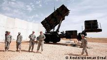 U.S. soldiers stand beside a U.S. Patriot missile system at a Turkish military base in Gaziantep, southeastern Turkey, October 10, 2014. NATO Secretary-General Jens Stoltenberg of Norway is expected to visit U.S. patriot troops in Gaziantep later in the day. REUTERS/Osman Orsal (TURKEY - Tags: POLITICS MILITARY CONFLICT)