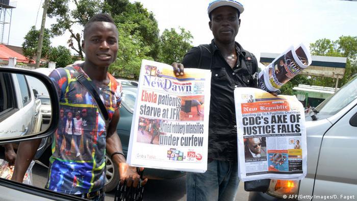 Two newspaper vendors in Liberia