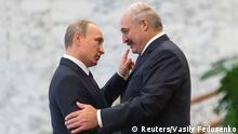 Belarus' President Alexander Lukashenko (R) greets his Russian counterpart Vladimir Putin at a meeting during a summit of the Commonwealth of Independent States (CIS) in Minsk, October 10, 2014. REUTERS/Vasily Fedosenko (BELARUS - Tags: POLITICS)