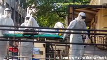 A man suspected of being infected with Ebola arrives at the Evandor Chagas National Institute of Infectious Diseases in Rio de Janeiro October 10, 2014. The patient with suspected Ebola was transferred to the National Institute of Infectious Evandro Chagas in Rio de Janeiro, a day after entering an Emergency Unit (UPA) in Cascavel, in the state of Parana. The man arrived in Brazil on September 19 from Guinea, and reported that he had a fever on Wednesday and Thursday. REUTERS/Mauro dos Santos (BRAZIL - Tags: HEALTH DISASTER TPX IMAGES OF THE DAY)