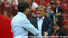 WARSAW, POLAND - OCTOBER 11: Joachim Loew (L), head coach of Germany talks to Adam Nawalka, heach coach of Poland prior to the EURO 2016 Group D qualifying match between Poland and Germany at Narodowy Stadium on October 11, 2014 in Warsaw, Poland. (Photo by Alexander Hassenstein/Bongarts/Getty Images)
