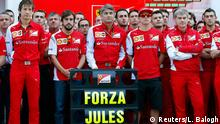 Members of Ferrari Formula One team pose with a sign in support of Marussia Formula One driver Jules Bianchi of France before the first Russian Grand Prix in Sochi October 12, 2014. Formula One drivers have backed proposals to introduce a 'virtual safety car' or automatic speed limiter that would force the entire field to slow when yellow warning flags are waved. The idea was raised by race director Charlie Whiting at the Russian Grand Prix on Saturday as one of the measures being considered following Bianchi's horrific crash in Japan last weekend. REUTERS/Laszlo Balogh (RUSSIA - Tags: SPORT MOTORSPORT F1)