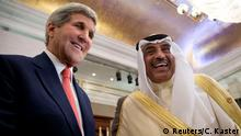 U.S. Secretary of State John Kerry greets Kuwaiti Foreign Minister Sabah Al-Khalid al-Sabah during the Gaza international donors conference in Cairo October 12, 2014. Kerry announced on Sunday an additional $212 million in aid to the Palestinian people at a Cairo conference on rebuilding Gaza following a war earlier this year. REUTERS/Carolyn Kaster/Pool (EGYPT - Tags: POLITICS)