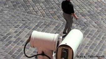A man in front of a surveillance camera